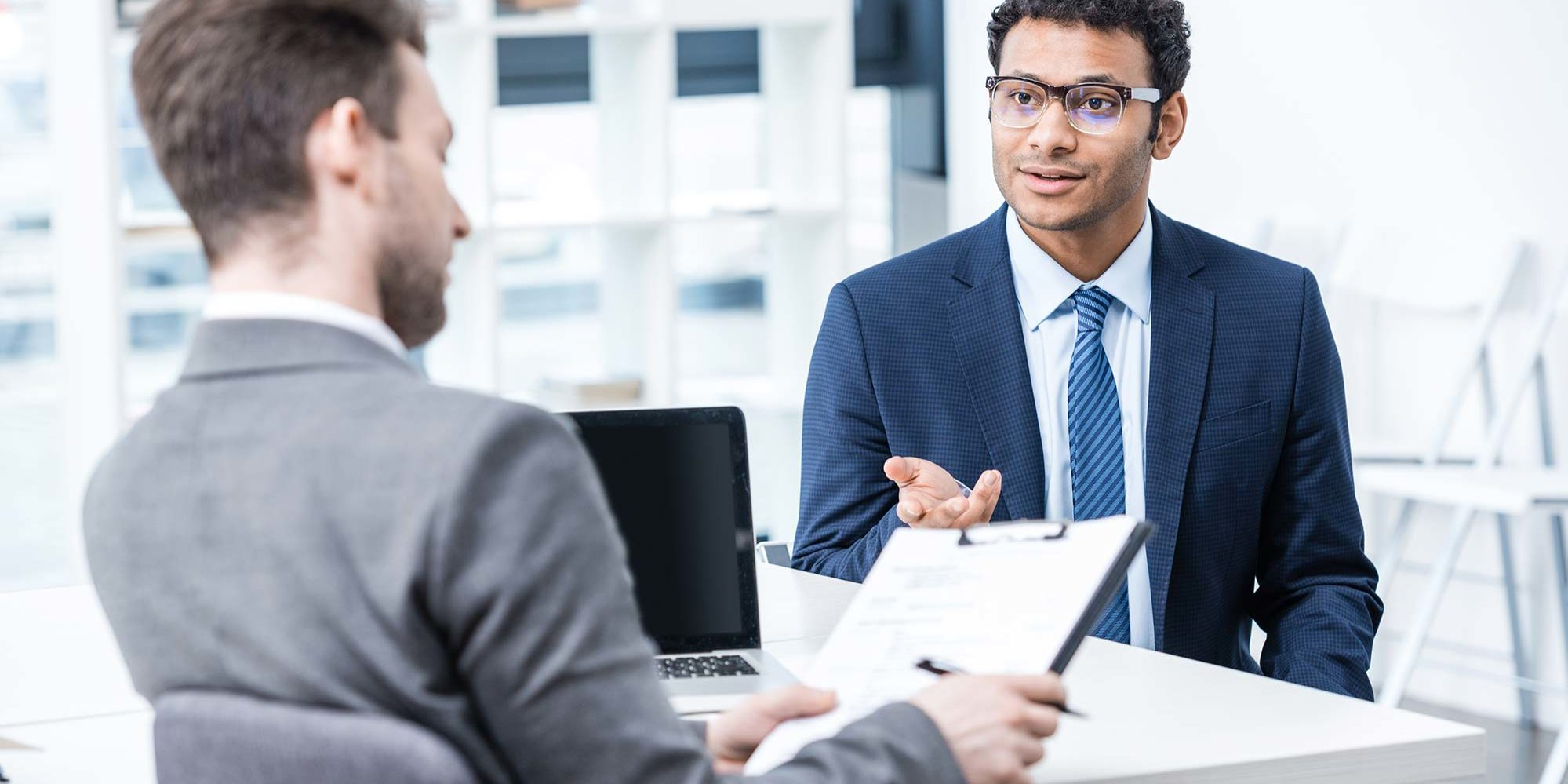 What important questions should a small business owner ask before hiring an accountant?